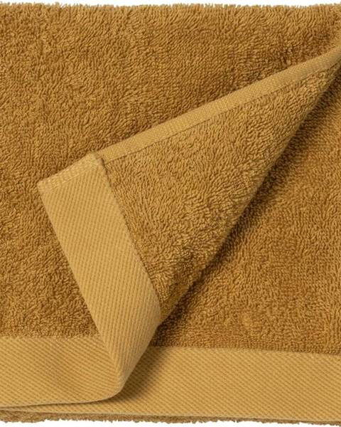 Södahl Žlutý ručník z froté bavlny Södahl Golden, 60 x 40 cm