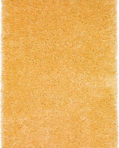 Žlutý koberec Universal Aqua Liso, 57 x 110 cm