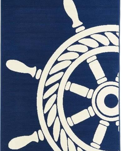 Tmavě modrý venkovní koberec Floorita Wheel, 133 x 190 cm
